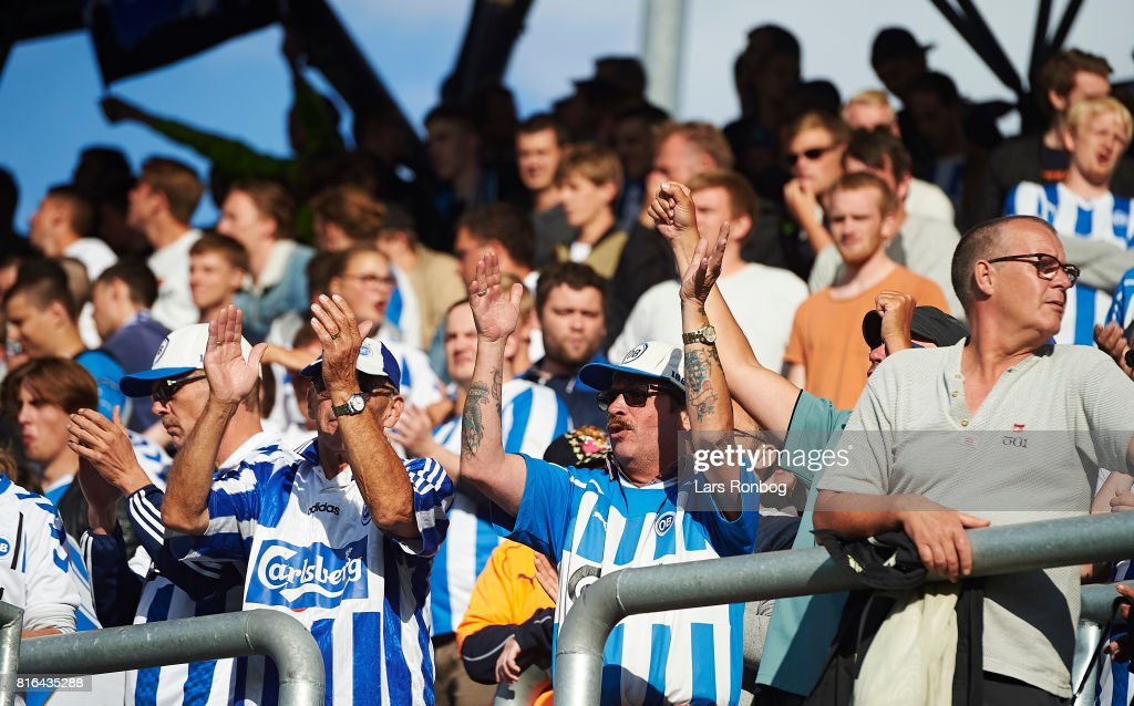 Fans of OB Odense cheer prior to the Danish Alka Superliga match between OB Odense and FC Nordsjalland at EWII Park on July 17, 2017 in Odense, Denmark.