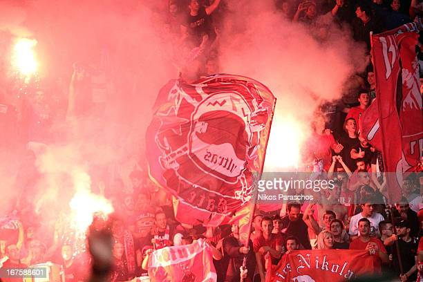 Fans of Olympiacos celebrate during the Turkish Airlines Euroleague 20122013 Play Offs game 5 between Olympiacos Piraeus v Anadolu Efes Istanbul at...