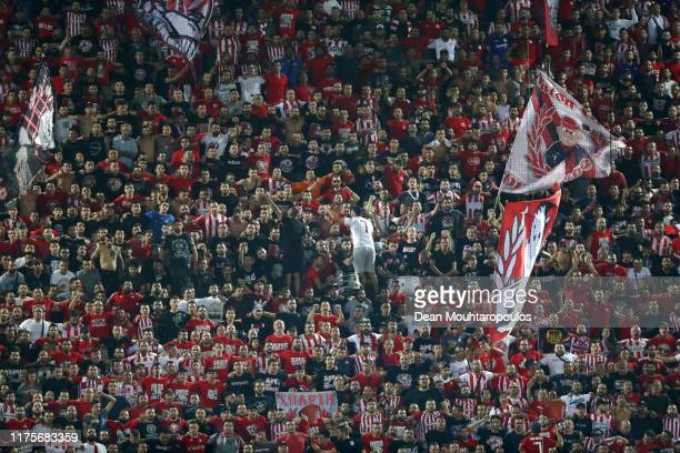 Fans of Olympiacos show their support during the UEFA Champions League group B match between Olympiacos FC and Tottenham Hotspur at Karaiskakis...