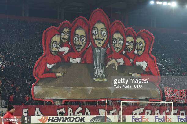 Fans of Olympiacos show theis support during the UEFA Europa League Group F match between Olympiacos and AC Milan at Karaiskakis Stadium on December...