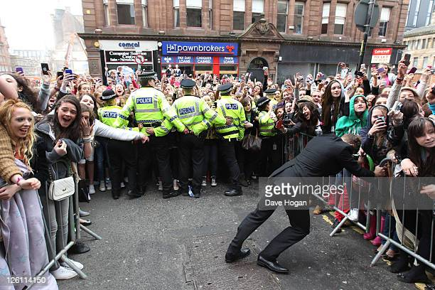 Fans of One Direction go crazy as the band visit Glasgow Manchester and London on September 11 2011 The tour was taken in a luxury helicopter to...