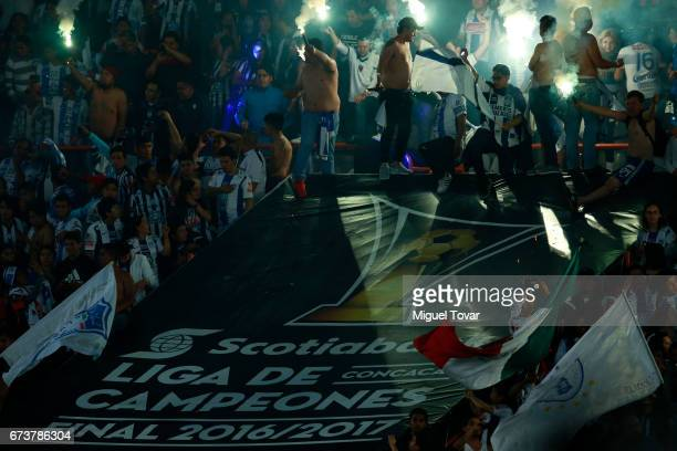 Fans of Pachuca light flares to celebrate after winning the Final second leg match between Pachuca and Tigres UANL as part of the CONCACAF Champions...
