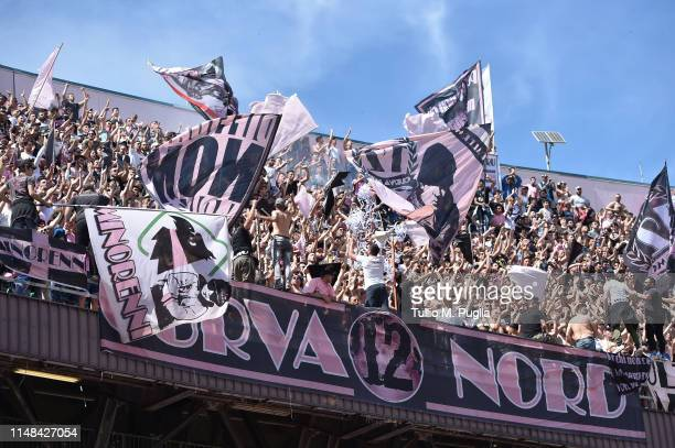 Fans of Palermo show his support during the Serie B match between US Citta di Palermo and AS Cittadella at Stadio Renzo Barbera on May 11 2019 in...