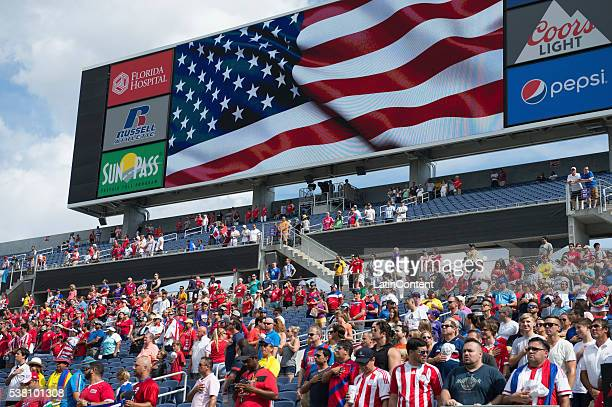 Fans of Paraguay cheer their team before a group A match between Costa Rica and Paraguay at Camping World Stadium as part of Copa America Centenario...