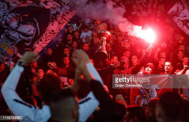 Fans of Partizan celebrate with the trophy after winning the Serbian Cup Final match between FK Crvena Zvezda and FK Partizan at stadium Rajko Mitic...