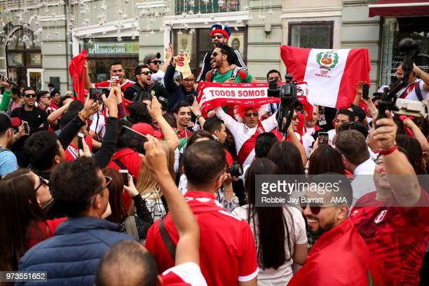 Fans of Peru and Morocco congregate on Nikolskaya Street a pedestrian street in KitayGorod in Moscow on June 13 2018 in Moscow Russia