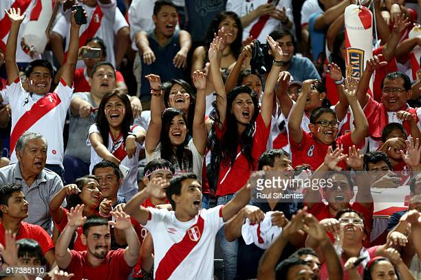 Fans of Peru cheer for their team during a match between Peru and Venezuela as part of FIFA 2018 World Cup Qualifiers at Nacional Stadium on March 24...