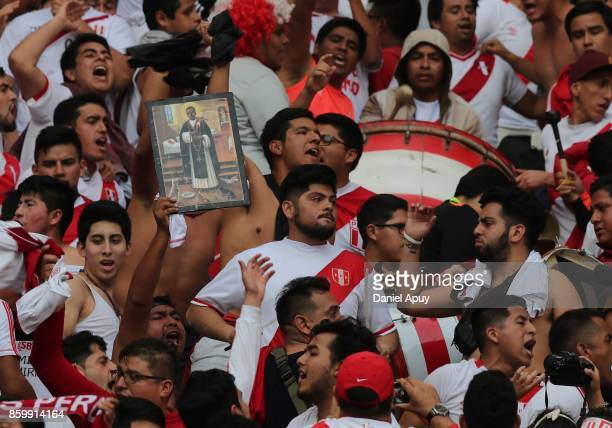 Fans of Peru cheer their team prior to a match between Peru and Colombia as part of FIFA 2018 World Cup Qualifiers at Monumental Stadium on October...