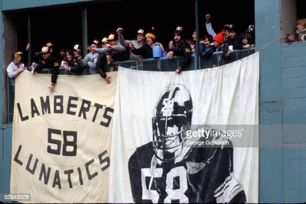 Fans of Pittsburgh Steelers linebacker Jack Lambert including members of the Lambert's Lunatics fan club cheer during a game at Three Rivers Stadium...
