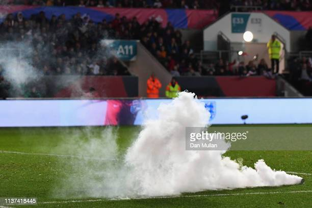Fans of Poland throw a flare on the ground during the U21 International Friendly match between England and Poland at Ashton Gate on March 21 2019 in...