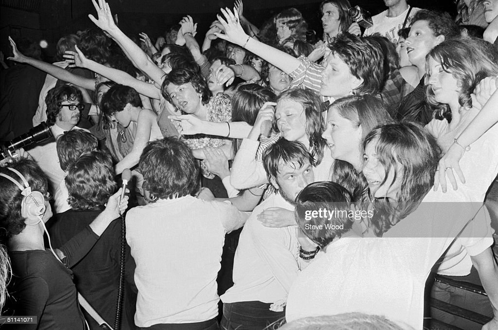 Fans of pop singer David Bowie at the last concert he performed in his Ziggy Stardust persona, at the Hammersmith Odeon, London, 3rd July 1973.