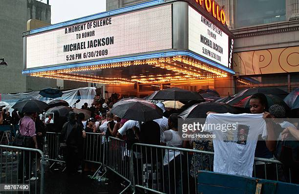 Fans of pop star Michael Jackson wait in line for hours outside the Apollo Theater in Harlem where the deceased pop star first performed at age 9...