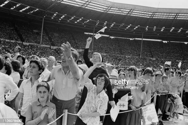 Fans of Pope John Paul II at Crystal Palace during his visit to the UK, London, 30th May 1982.