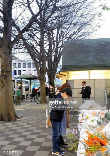 Fans of popular comedian Ken Shimura who died of the coronavirus offer flower at a makeshift altar installed near the Trees of Ken Shimura in front...