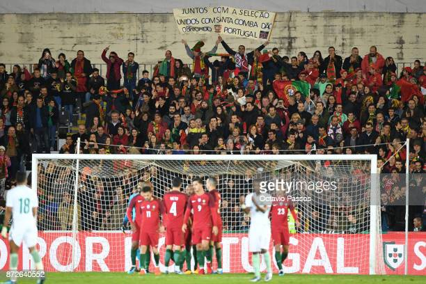 Fans of Portugal celebrates after the national team scores the first goal during the International Friendly match between Portugal and Saudi Arabia...
