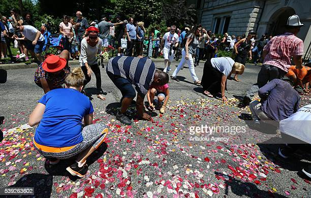 Fans of professional boxer Muhammad Ali collect the rose petals during a public funeral procession and memorial service for the former boxing world...