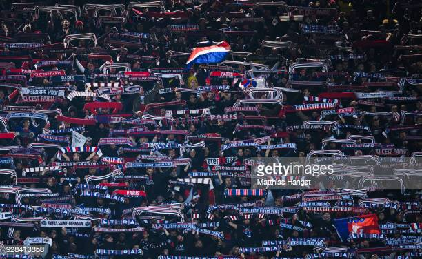 Fans of PSG celebrate during the UEFA Champions League Round of 16 Second Leg match between Paris SaintGermain and Real Madrid at Parc des Princes on...