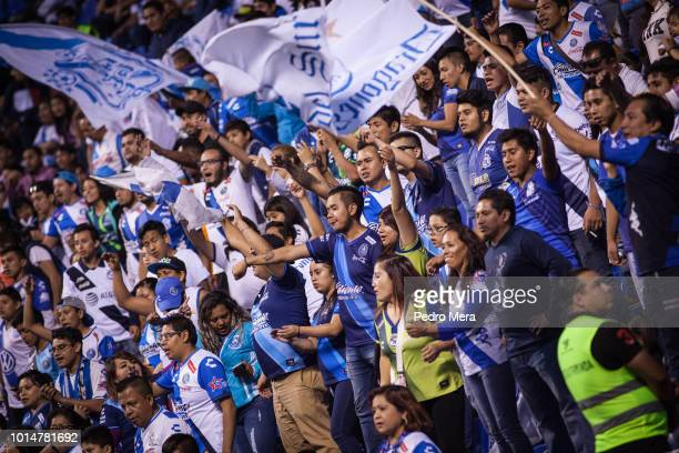 Fans of Puebla cheer for their team during a match between Puebla and Veracruz as part of Torneo Apertura Liga MX at Estadio Cuauhtemoc on August 10...