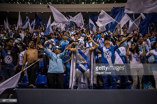 Fans of Puebla cheer for their team during the opening friendly match between Puebla and Boca Juniors at Cuauhtemoc Stadium on November 18 2015 in...