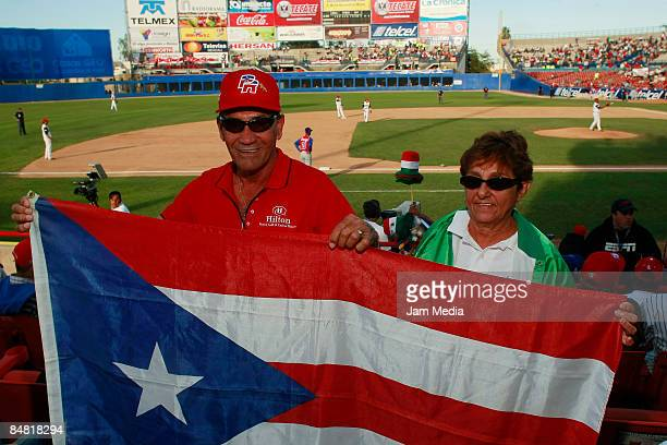 Fans of Puerto Rico hold the National Flag during the game between Costa Rica against Dominican Republic in the Caribbean series 2009 on February 3...