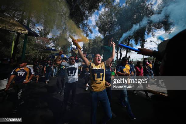 Fans of Pumas cheers during the 3rd round match between Pumas UNAM and Monterrey as part of the Torneo Clausura 2020 Liga MX at Olimpico...