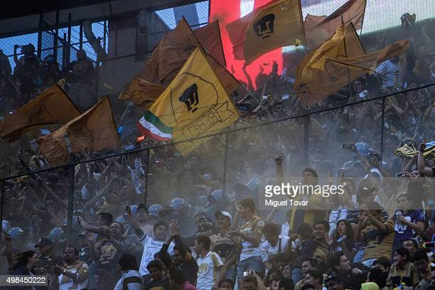 Fans of Pumas sing during the 17th round match between America and Pumas UNAM as part of the Apertura 2015 Liga MX at Azteca Stadium on November 21...