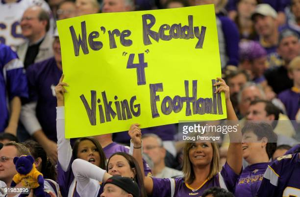 Fans of quarterback Brett Favre of the Minnesota Vikings display signs in his support against the Baltimore Ravens during NFL action at Hubert H...