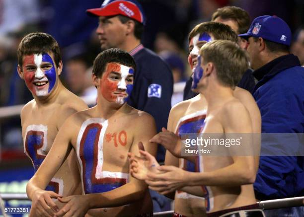 Fans of quarterback Eli Manning of the New York Giants attend the game against the Atlanta Falcons at Giants Stadium on November 21, 2004 in East...