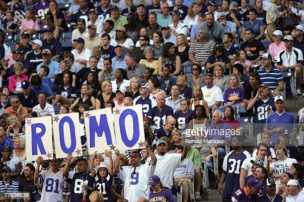 Fans of quarterback Tony Romo of the Dallas Cowboys hold up a sign during the game against the Minnesota Vikings at Texas Stadium on October 21 2007...
