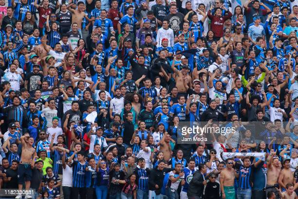 Fans of Queretaro cheer for their team during the 14th round match between Atletico San Luis and Queretaro as part of the Torneo Apertura 2019 Liga...