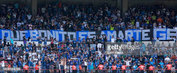 Fans of Queretaro cheer for their team during the the 7th round match between Queretaro and Lobos BUAP as part of the Torneo Apertura 2018 Liga MX at...