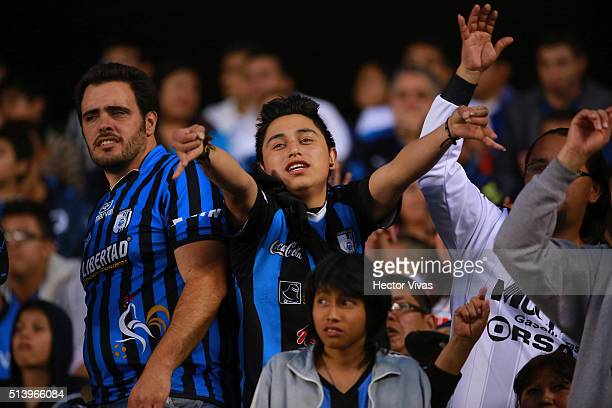 Fans of Queretaro sing during the 9th round match between Queretaro and Chivas as part of the Clausura 2016 Liga MX at La Corregidora Stadium on...