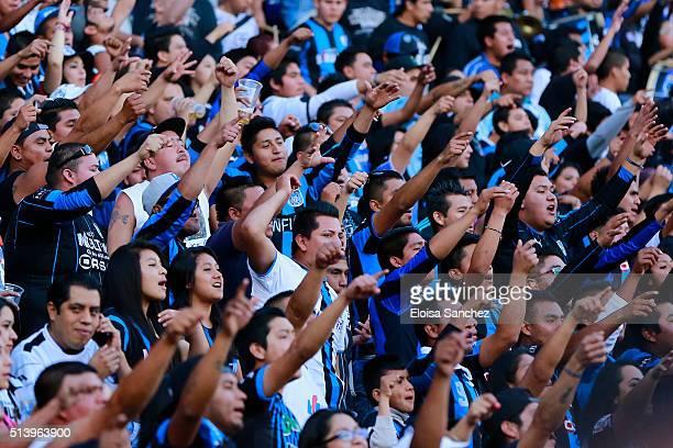 Fans of Queretaro sing prior the 9th round match between Queretaro and Chivas as part of the Clausura 2016 Liga MX at La Corregidora Stadium on March...