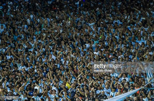 Fans of Racing Club cheer for their team during a match between Racing Club and Godoy Cruz at Juan Domingo Peron Stadium on February 18 2019 in...
