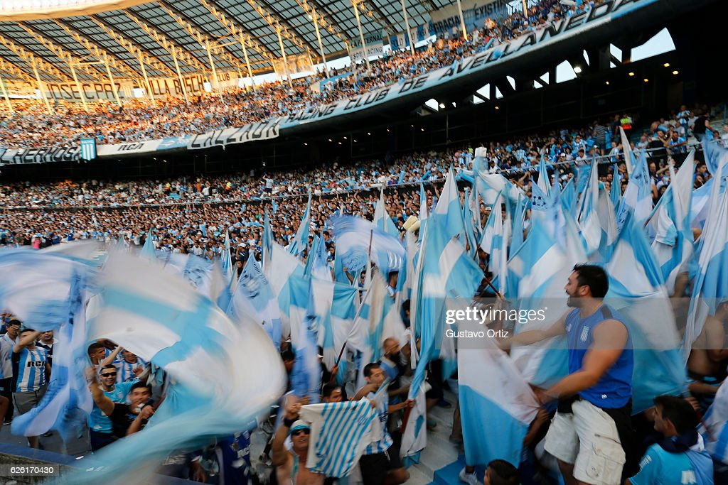 Fans of Racing Club cheer their team prior to a match between Racing Club and Independiente as part of Torneo Primera Division 2016/17 at Presidente Peron Stadium on November 27, 2016 in Avellaneda, Argentina.