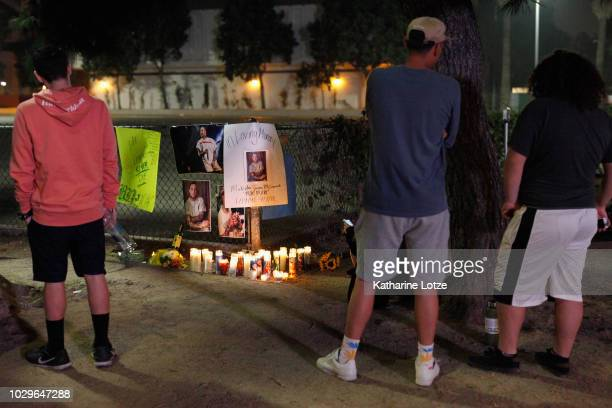 Fans of rapper Mac Miller stand near a memorial at the corner of Fairfax and Melrose Avenues on September 8 2018 in Los Angeles California Miller...