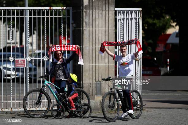 Fans of RB Leipzig pose for a photo outside the Red Bull Arena prior to the Bundesliga match between RB Leipzig and Sporting-Club Freiburg on May 16,...