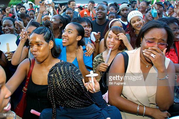 Fans of RB singer Aaliyah Haughton gather at a memorial candlelight vigil August 27 2001 in Detroit Michigan at Aaliyah''s old school the Detroit...