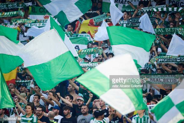 Fans of Real Betis Balompie cheer for their team during the La Liga match between Real Betis Balompie and Athletic Club at Estadio Benito Villamarin...