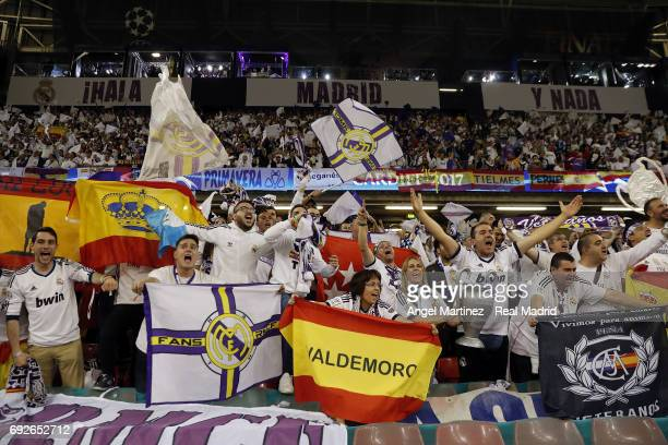 Fans of Real Madrid cheer during the UEFA Champions League Final match between Juventus and Real Madrid at National Stadium of Wales on June 3 2017...