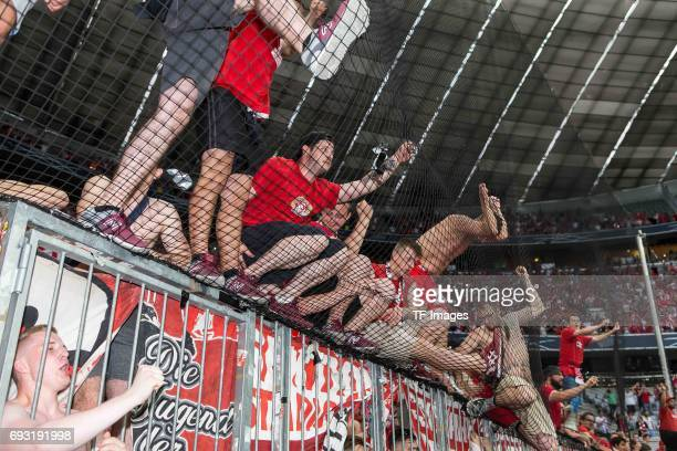 Fans of Regensburg celebrate their win after the Second Bundesliga Playoff second leg match between TSV 1860 Muenchen and Jahn Regensburg at Allianz...
