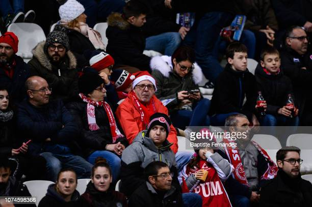 Fans of Reims with a Santa Claus hat before the French Ligue 1 Football match between Stade Reims and SM Caen at Stade Auguste Delaune on December 22...