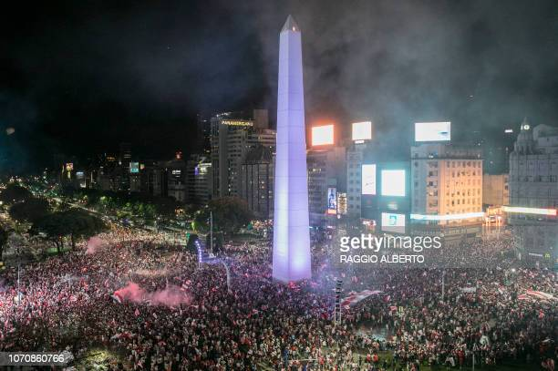 TOPSHOT Fans of River Plate celebrate at the Plaza de la Republica Buenos Aires Argentina after the team won the allArgentine Copa Libertadores final...