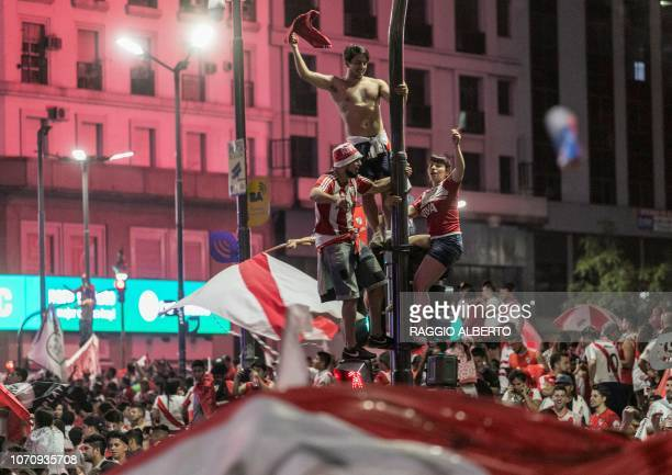 Fans of River Plate celebrate at the Plaza de la Republica Buenos Aires Argentina after the team won the allArgentine Copa Libertadores final against...