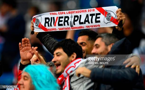 Fans of River Plate cheer at the Santiago Bernabeu stadium in Madrid just hours before the start of the second leg match of the allArgentine Copa...