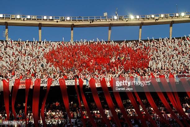 Fans of River Plate cheer before a match between River Plate and Boca Juniors as part of 24th round of Torneo Primera Division 2015 at Monumental...
