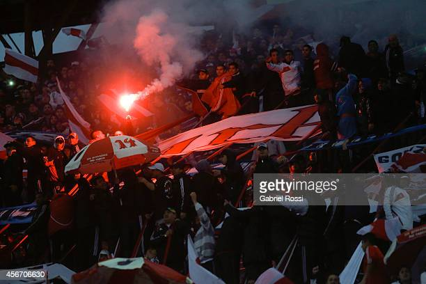 Fans of River Plate cheer for their team before a match between River Plate and Boca Juniors as part of 10th round of Torneo de Transicion 2014 at...