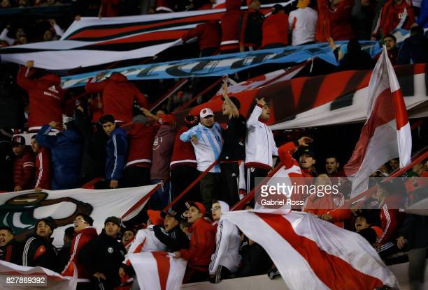 Fans of River Plate cheer for their team before a second leg match between River Plate and Guarani as part of round of 16 of Copa CONMEBOL...