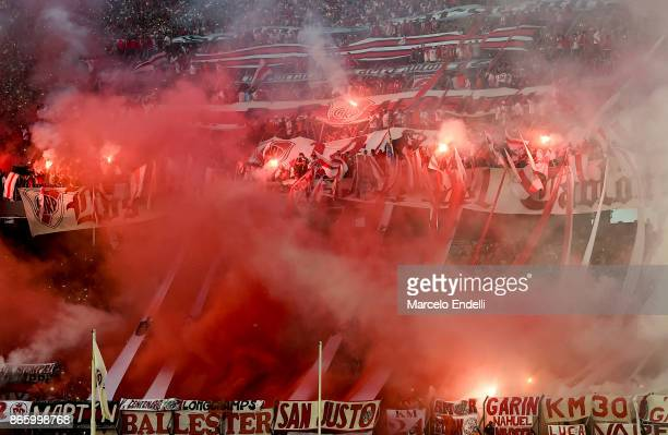 Fans of River Plate cheer for their team during a first leg match between River Plate and Lanus as part of semifinals of Copa CONMEBOL Libertadores...