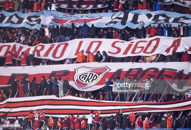 Fans of River Plate cheer for their team during a match between River Plate and Aldosivi as part of Torneo Primera Division 2016/17 at Monumental...